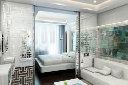 Раздвижные двери в интерьере спальни совмещенной с гостиной