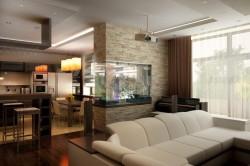 Зонирование совмещенной кухни с гостиной при помощи части стены