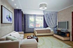 Зонирование комнаты при помощи штор