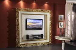 Украшение стены с телевизором багетной рамкой